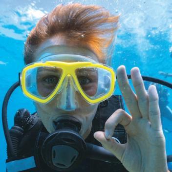 Visage d'une plongeuse illustrant les flyer sécurité